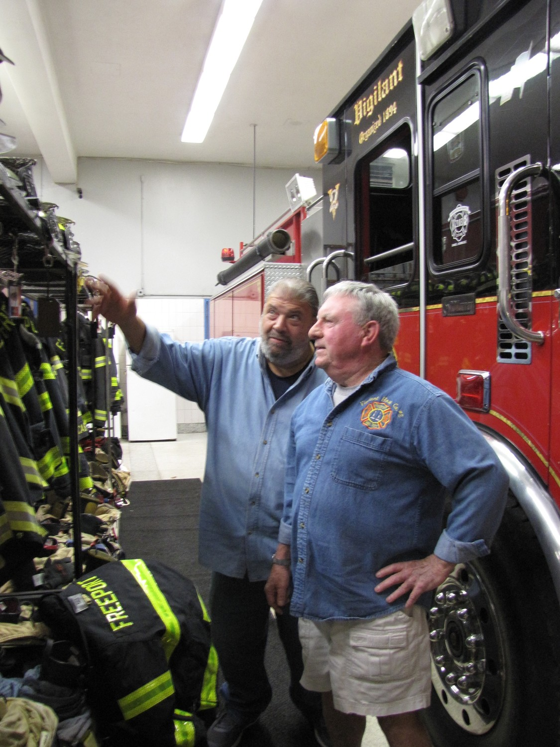 Though retired from their careers, Freeport firefighters Anthony Basile, left, and Edward Martin continue to volunteer with the department as mentors and supporters of younger firefighters.