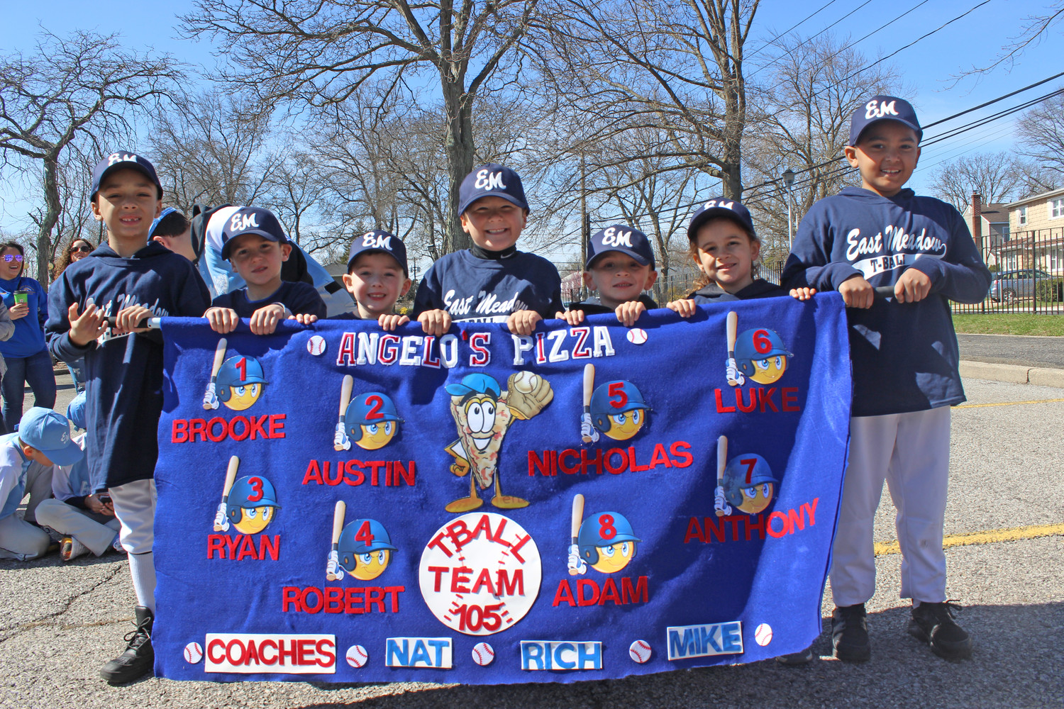 The above athletes marched with their banner sponsored by Angelo's Pizza in East Meadow.