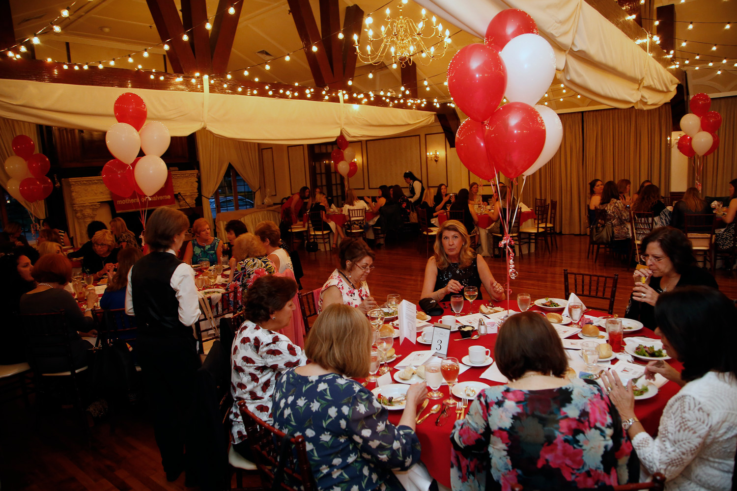 Members of the Moms of Malverne celebrated their 40th anniversary at the Stewart Manor Country Club on May 3.