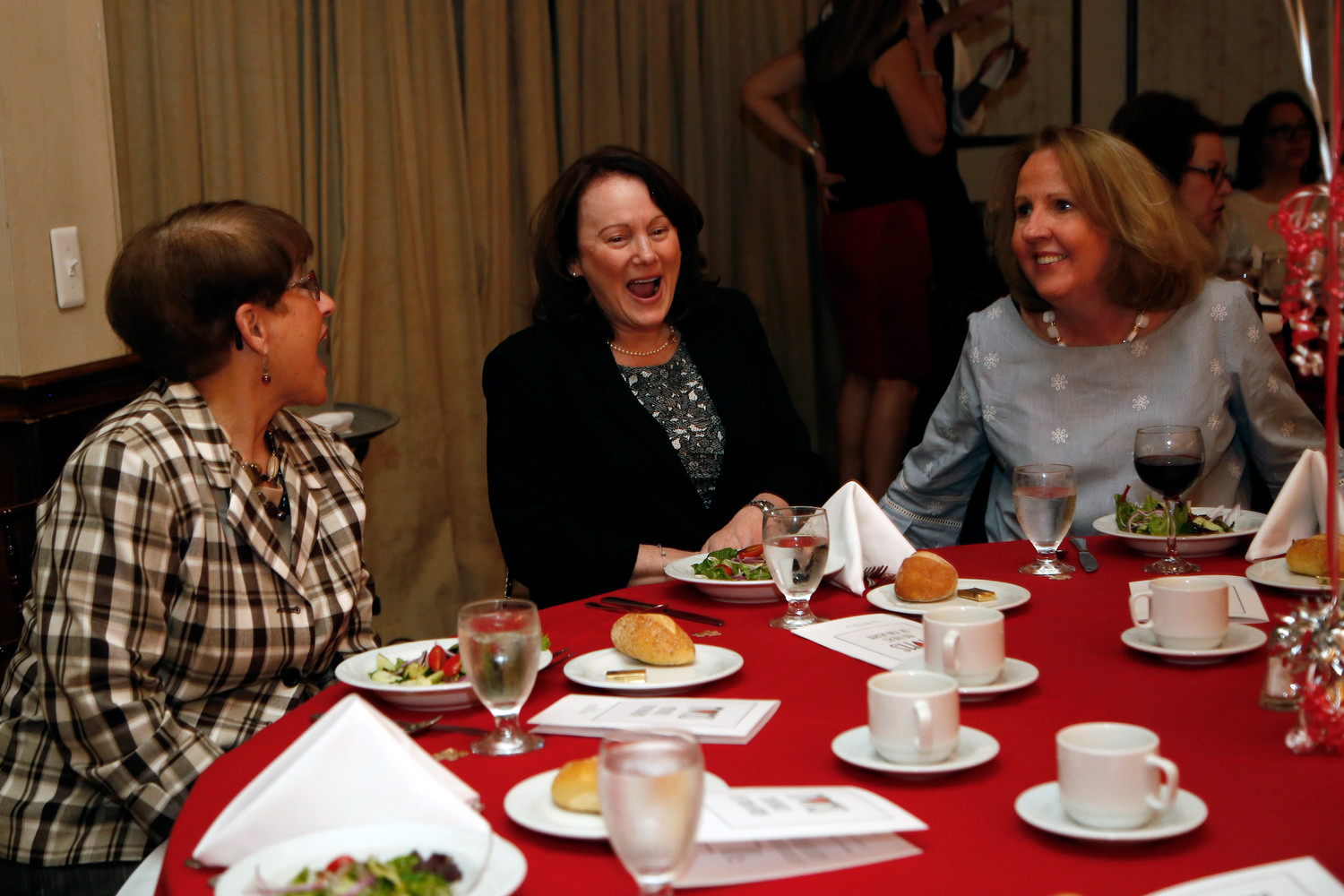 Peggy Urick, left, Joanne Tesoriero and Annmarie Pardo shared a laugh at the dinner.