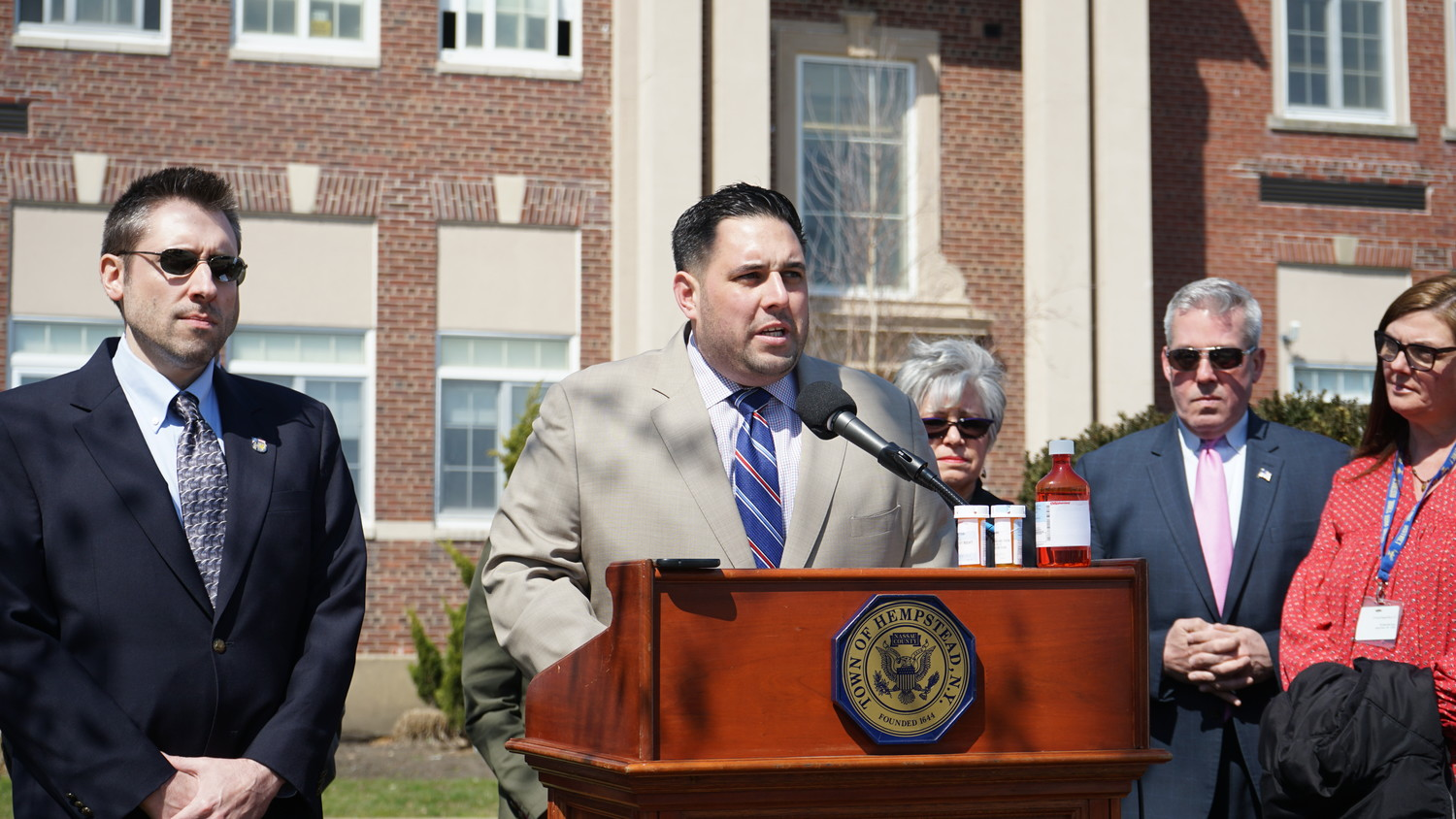 Town Councilman Anthony D'Esposito, center, introduced a program intended to help prevent prescription drug poisoning among children. Town Medical Director Dr. David Neubert, left, and Island Park school officials joined him.
