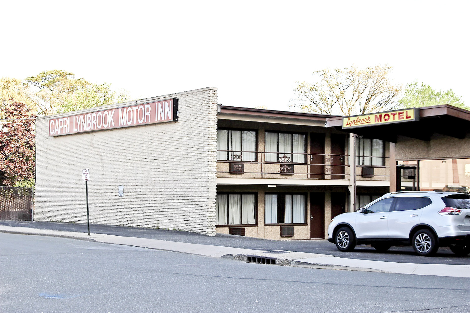 Police arrested two heroin dealers after a Lynbrook woman died of an overdose at the Capri Lynbrook Motor Inn. Village officials are continuing to probe hotel owners amid a series of crimes committed at the facility.