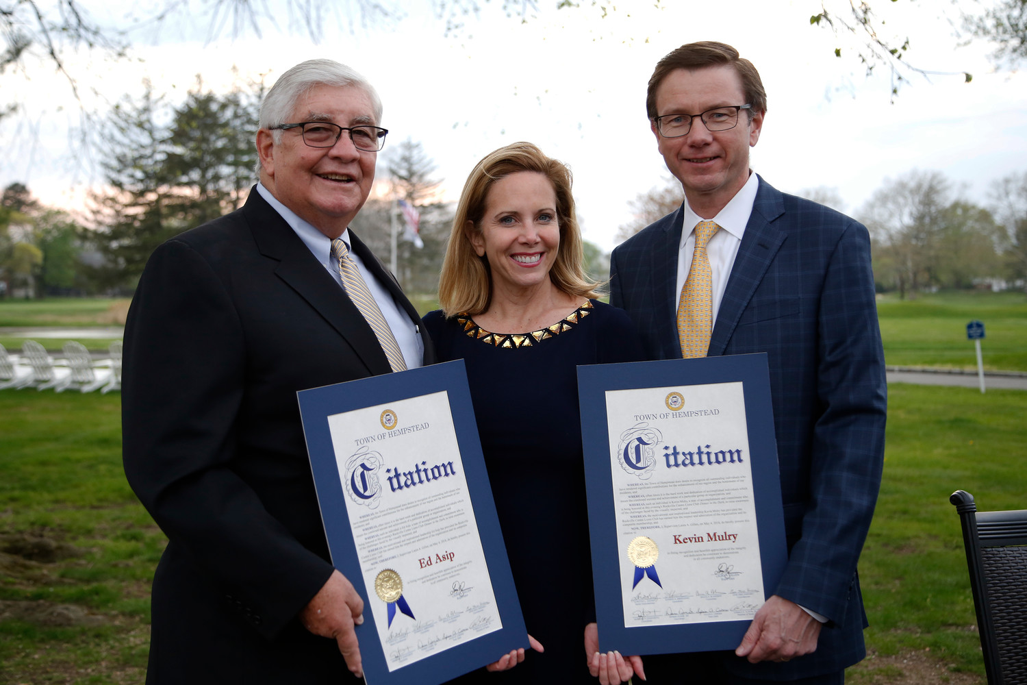 Town of Hempstead Supervisor Laura Gillen, middle, recognized honorees Ed Asip and Kevin Mulry.