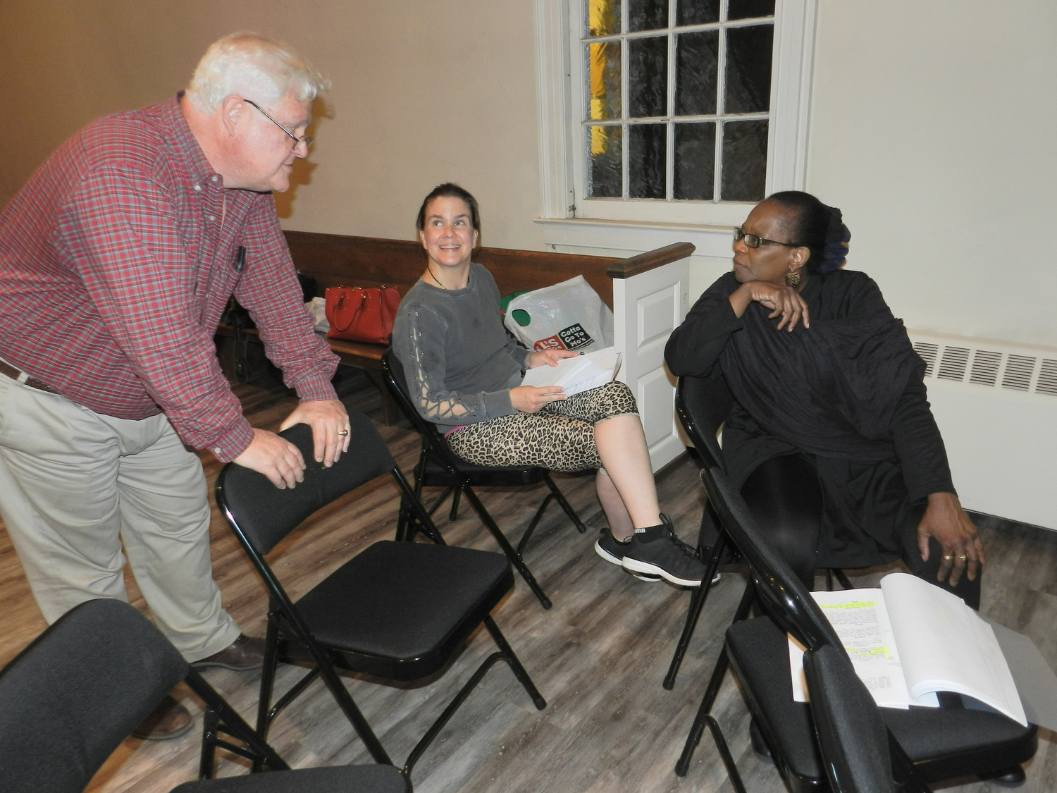 Director Patrick Reilly, left, of Freeport, reviewed a scene with cast members Olivia Hill and Alisha Evans.