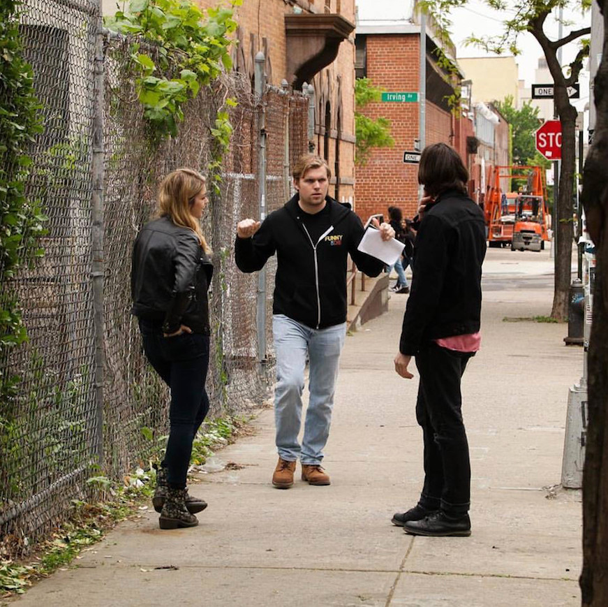 Filmmaker Ryan McDonough, center, spoke with Sydney Shepherd, who plays Melanie Matthews, and Sam Forrest, who plays James Parker, before a scene.