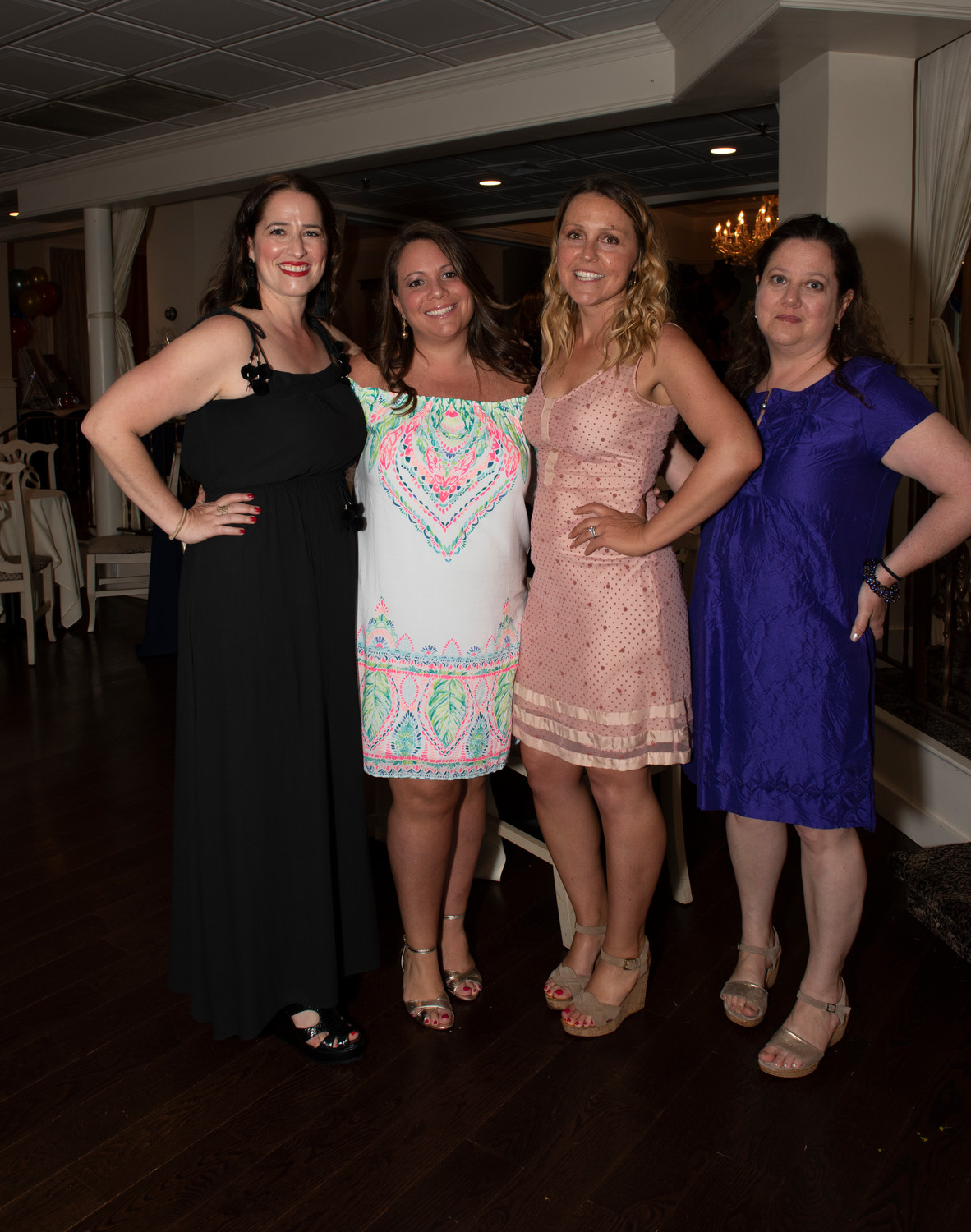 Event co-chairs Lisa Cashman, left, and Vanessa Marks, and PCA co-presidents Amelia Hecker and Natasha Gordon took the opportunity to show off their fashion poses at the fundraiser.