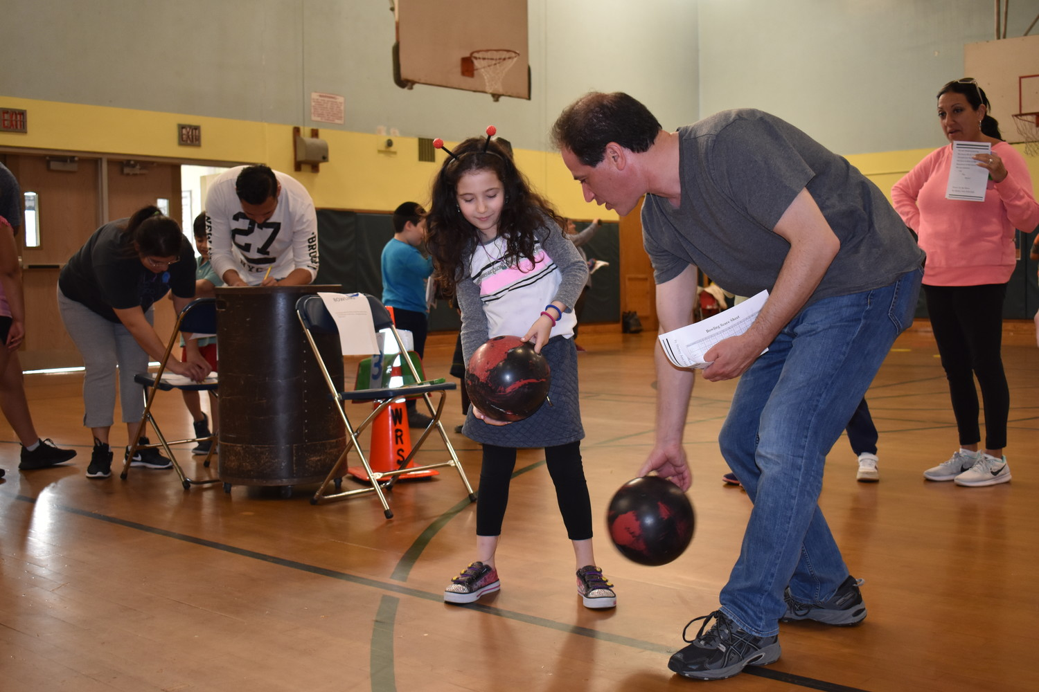 At Fun Family Fitness Night Lili Farber, 6, learned how to bowl from her father Sam.
