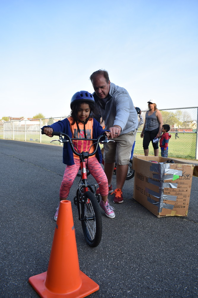 Lawrence physical education teacher Don Makofske helped Valerie Via, 8, learn how to balance on a bicycle.