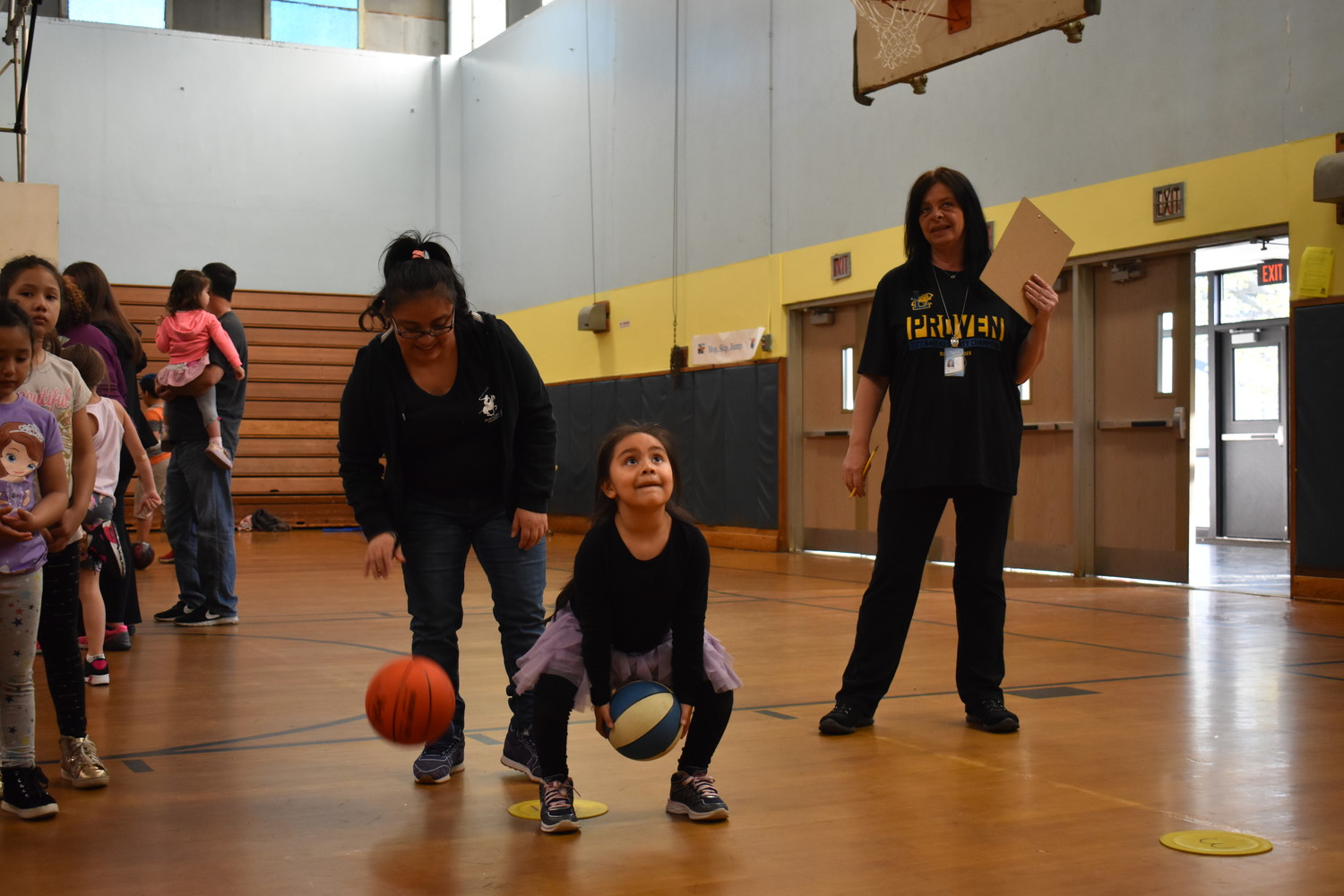While channeling her inner Rick Barry at the foul line, Allisson Rivas, 6, and her mother, Marlen, played the shooting game Around the World.