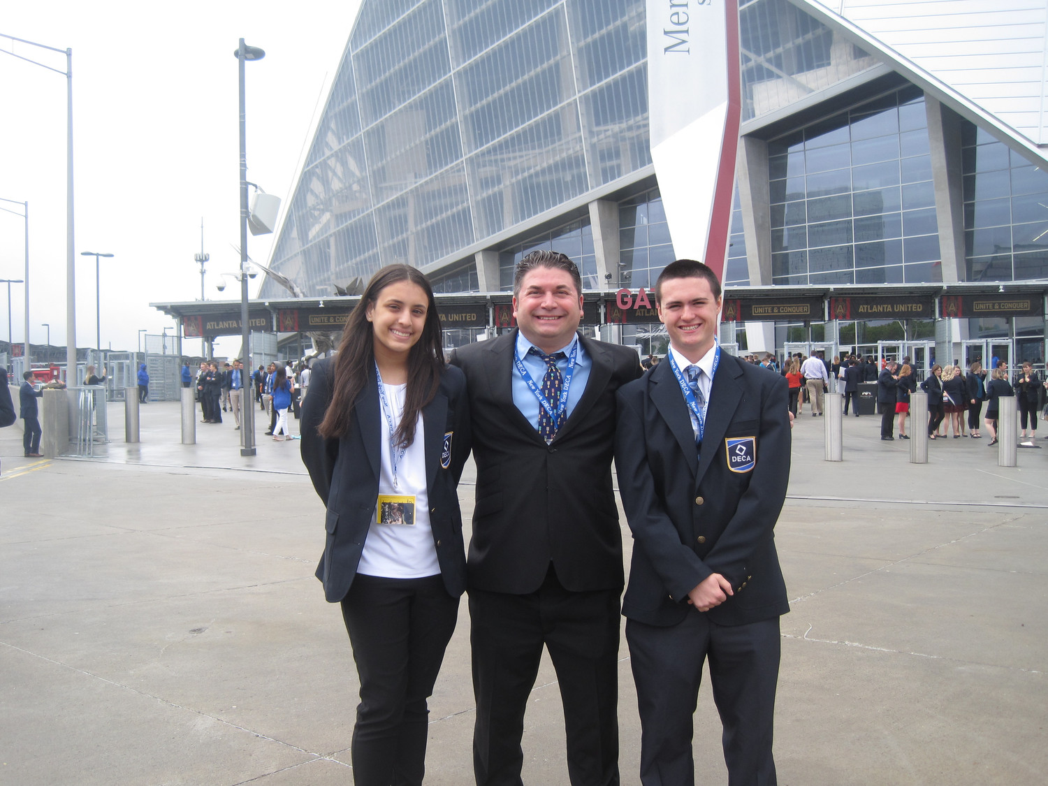 Two Lawrence High School students took part in the international DECA competition in the category of Hospitality & Tourism Professional Selling in Atlanta last month. From left freshman Danielle Hance, DECA advisor Mark Albin and junior John Loughlin Jr.