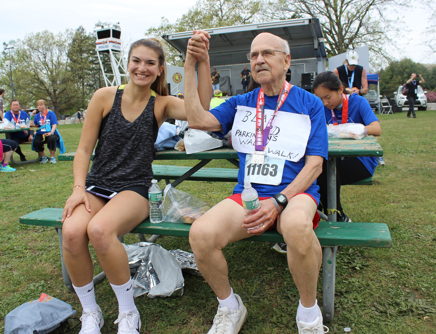 Nestor Barrezueta, 83, of East Meadow, has battled Parkinson's for 20 years, but he doesn't let it stop him from running. He competed in the Long Island Marathon last Sunday with his granddaughter Anna Paulik, 22.