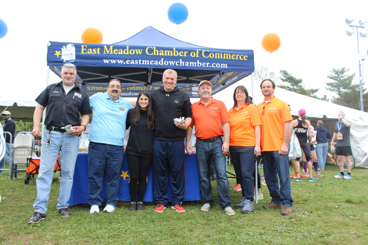 The East Meadow Chamber of Commerce greeted residents and runners at the Long Island Marathon's post-race festival. Above were, from left, President Frank Camarano; Anthony Sereno; Callie Ognibene; Michael Levy; John DeCelle, president and chief executive officer of the Nassau Financial Federal Credit Union; and Victoria and Peter Aievoli.
