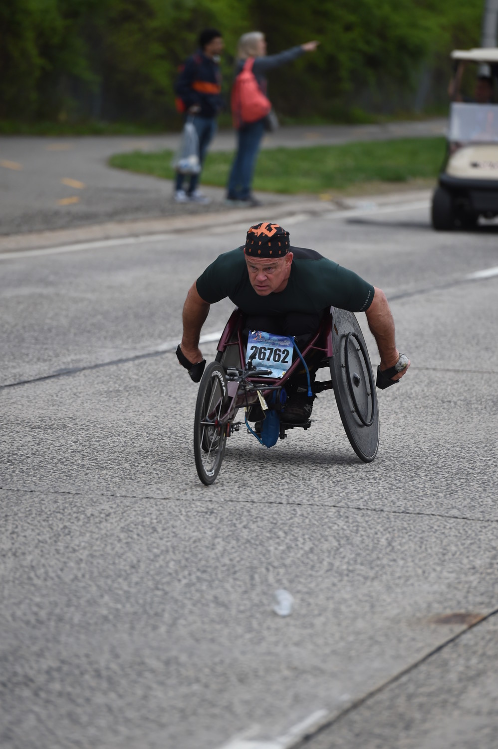 Peter Hawkins, 54, a wheelchair competitor from Malverne, was the first to cross the finish line of the marathon at 2:21:11.