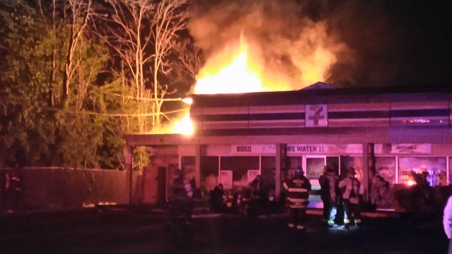 Fire engulfs the roof of the 7-11 on Sandhill Road in Wantagh at 1:32am