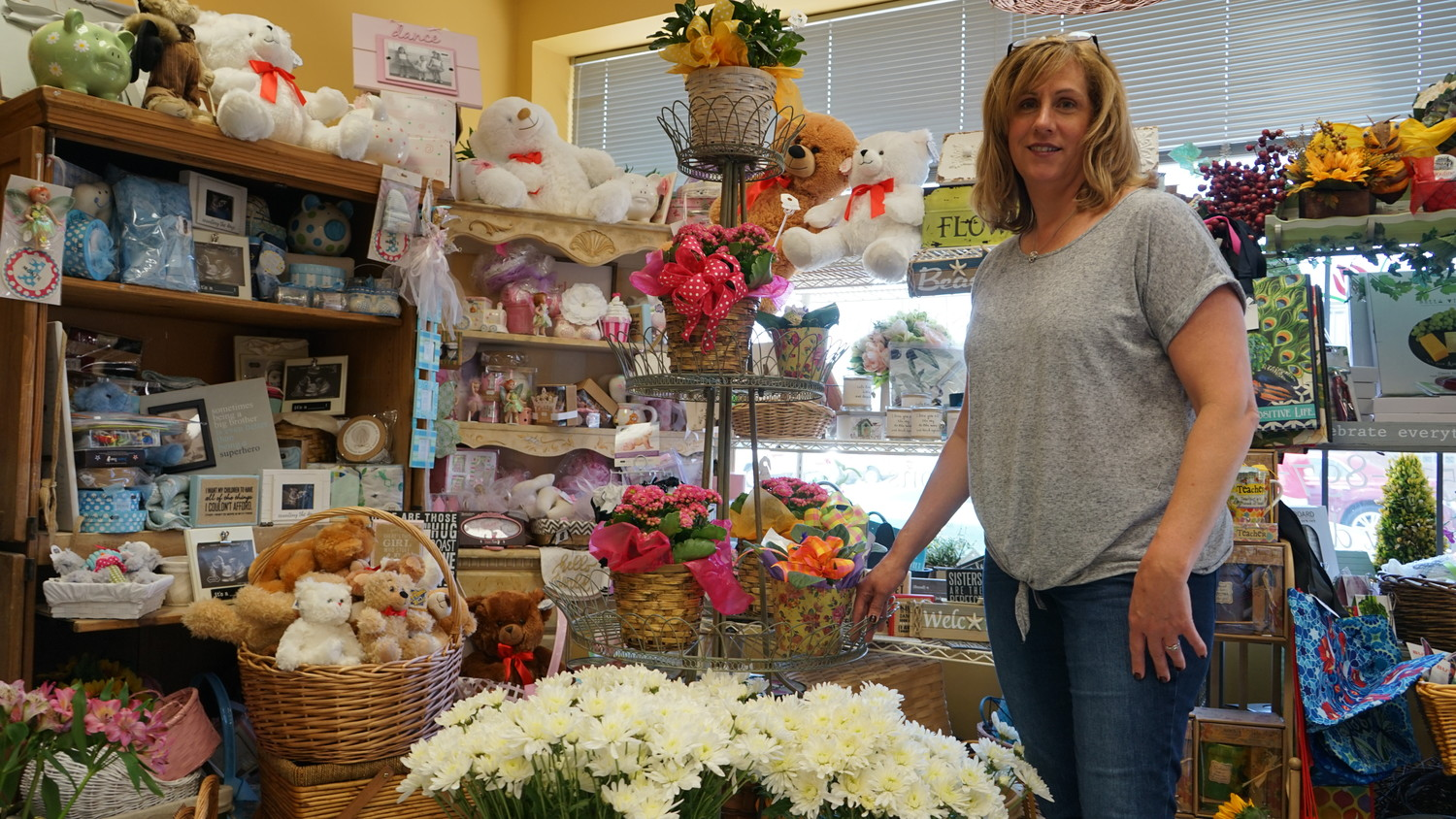 Doris the Florist has a wide variety of gifts to go with any flower arrangement a customer might want.