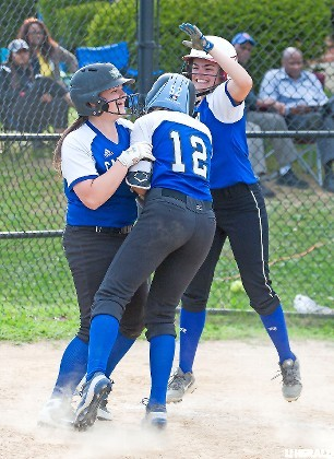 Calhoun's Heather Berberich, No. 12, was met by teammates Taylor Baumann, right, and Keri McLaughlin after hitting a three-run homer in last Friday's 13-0 playoff win at Baldwin.