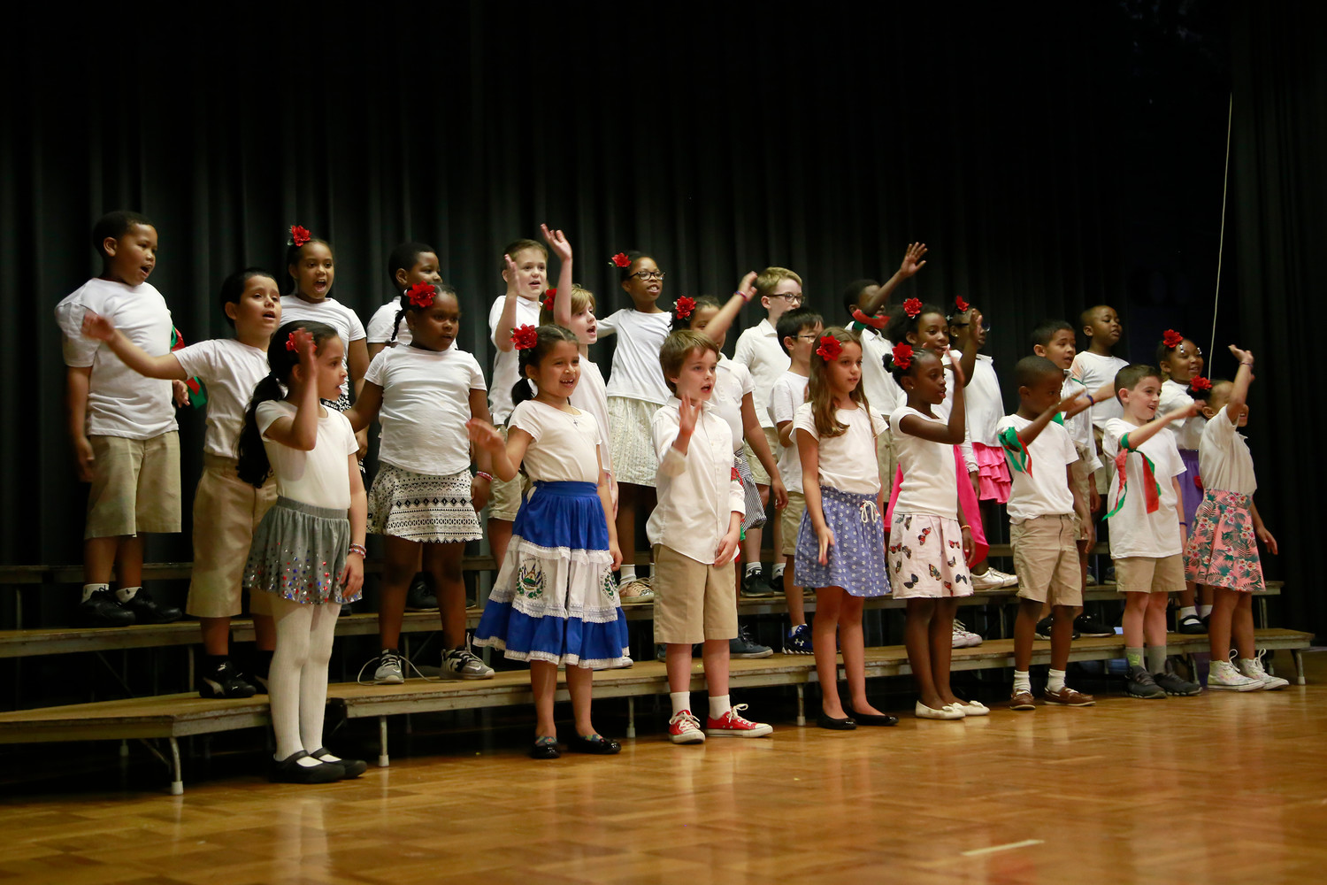 "Second-graders at St. Thomas the Apostle School sang ""Hello to All the Children of the World"" during International Day — A Celebration of Diversity."