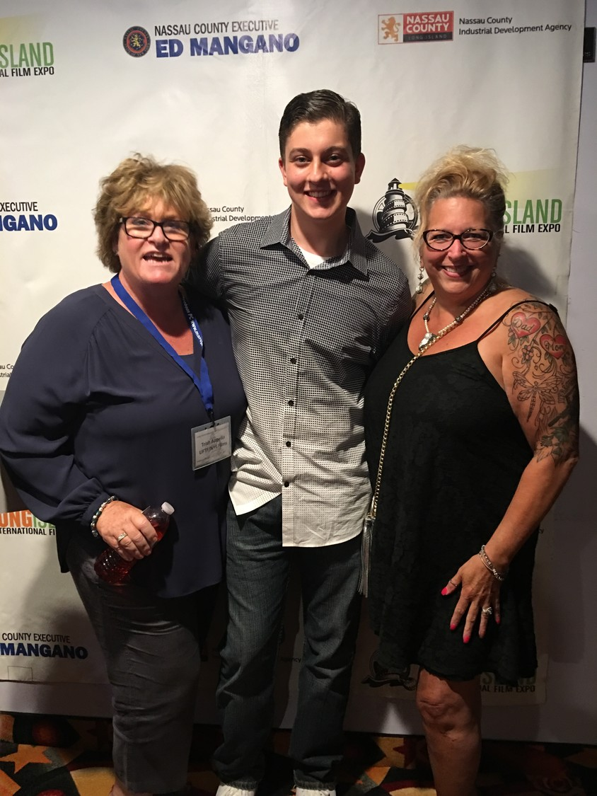 Mike Saporito was named the first recipient of the Keith Lane Visual & Media Arts Scholarship last year. Above, Saporito with Lane's sister, Stacy Lane-Navarra, far right, and scholarship committee member Trish Apperlo.