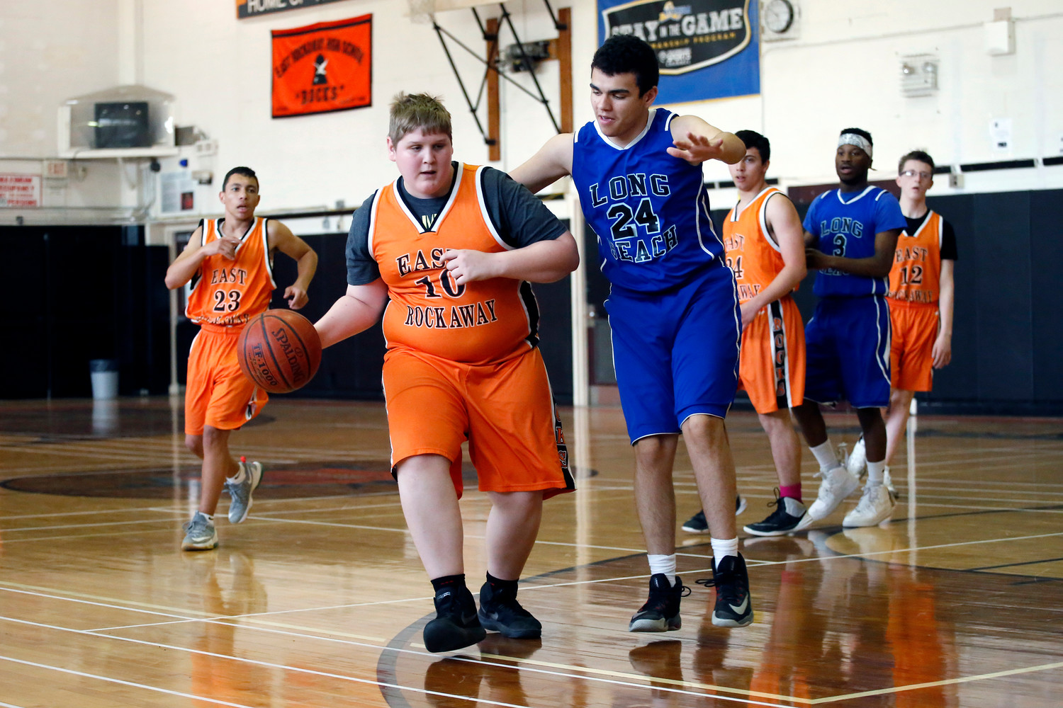 The unified basketball team comprises special needs students as well as students in the general education program.