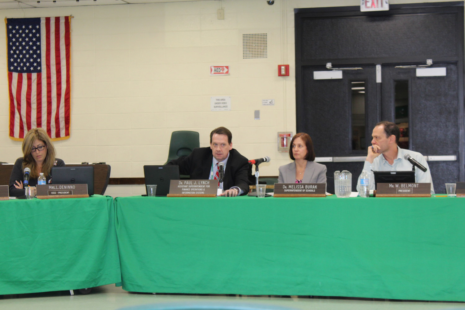 Superintendent Dr. Melissa Burak, second from right, announced at a recent Board of Education meeting that the Lynbrook Kindergarten Center will have to extend its hours of instruction next year.