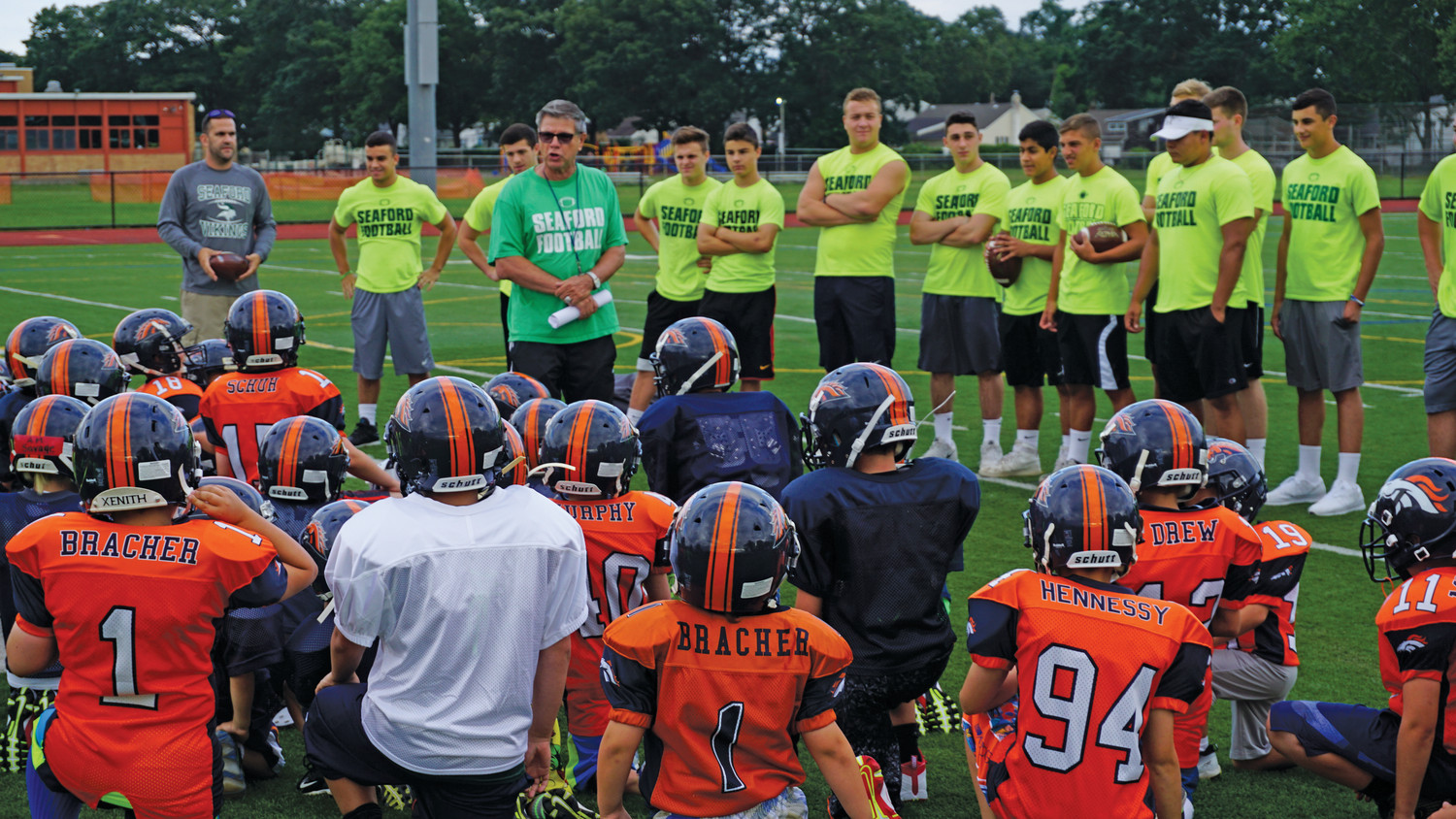 "Seaford High School's head football coach, Rob Perpall, ran clinics with the L.I. Broncos. He voiced his support for the Broncos' new modified program, calling it a ""win-win for everyone, including the parents."""