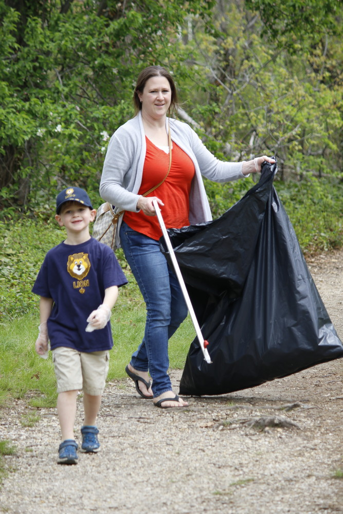 Lion Scout Nicholas Pellegrino, of Wantagh, wanted to stay and clean up every last path of Twin Lakes Preserve. His mother, Kate, assured him that they can come back whenever he wants to pick up trash.