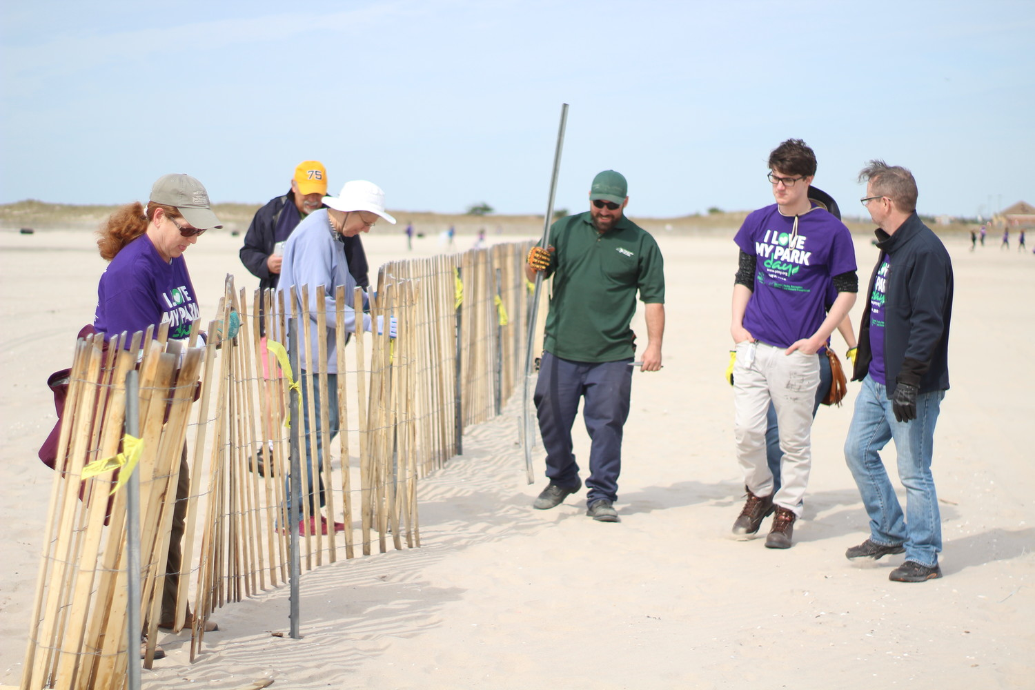 Jones Beach State Park supervisors and volunteers set up snow fencing, which is used to make sand dunes and creates an emergency lane for the upcoming air show.