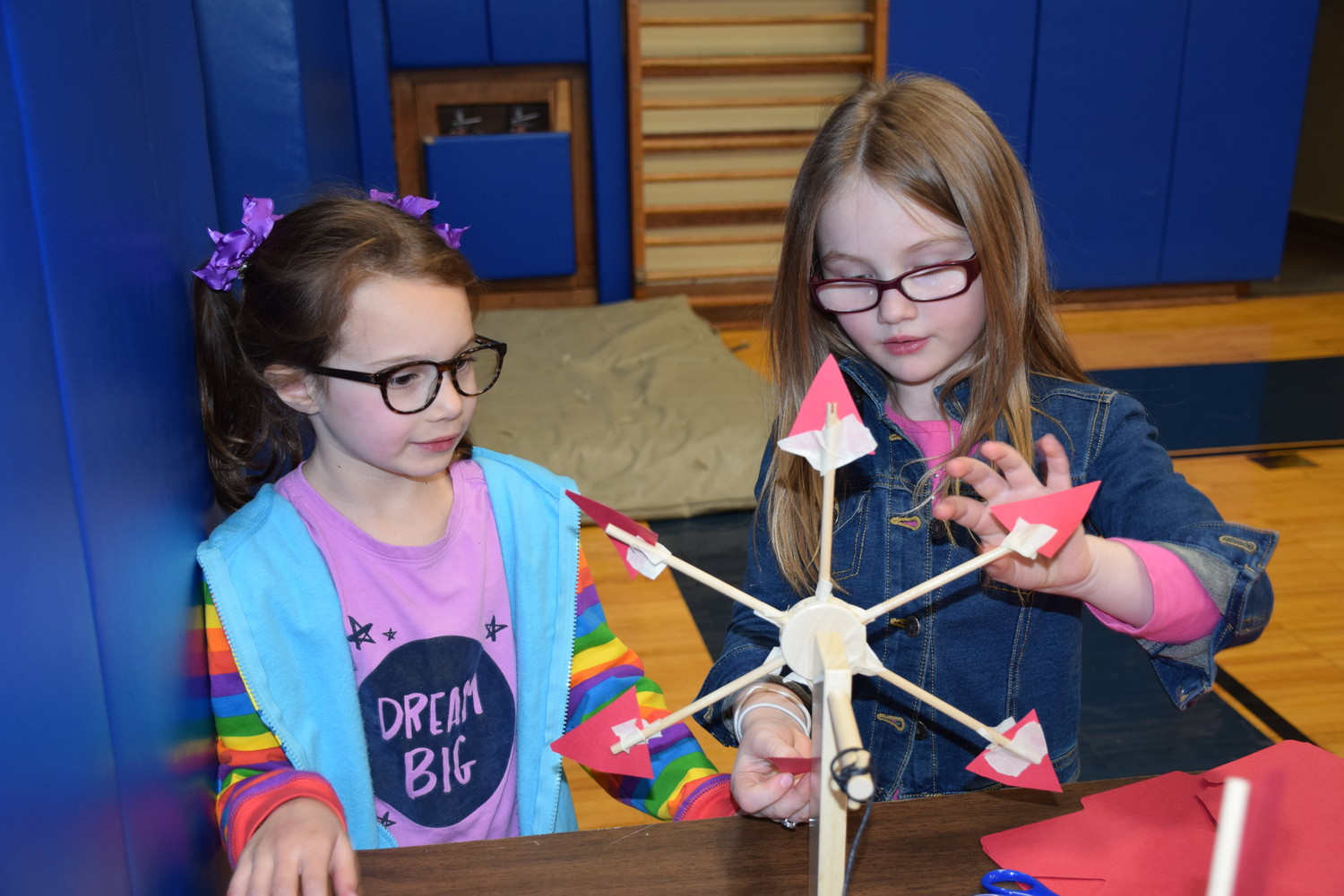 Kindergartner Kaya McKeel, left, and first-grader CarrieAnne Corry made windmills during Mandalay's STEAM night.