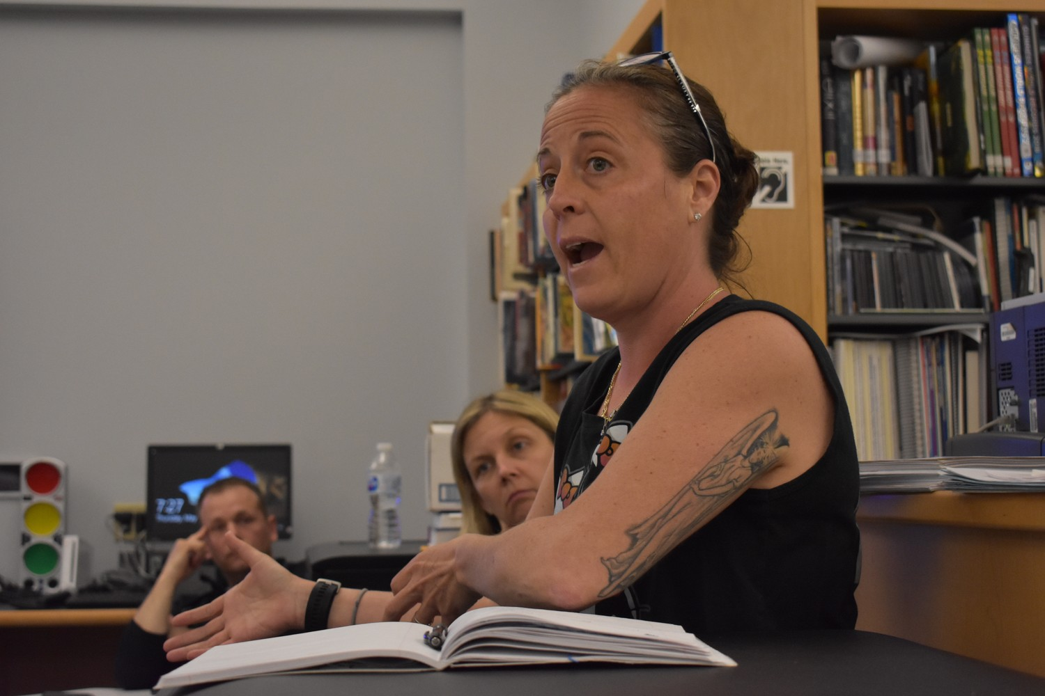 "Elizabeth Licata, a mother with three children in the district, said that some students with special needs are ""falling through the cracks"" at a forum in the South Side Middle School library on May 4."