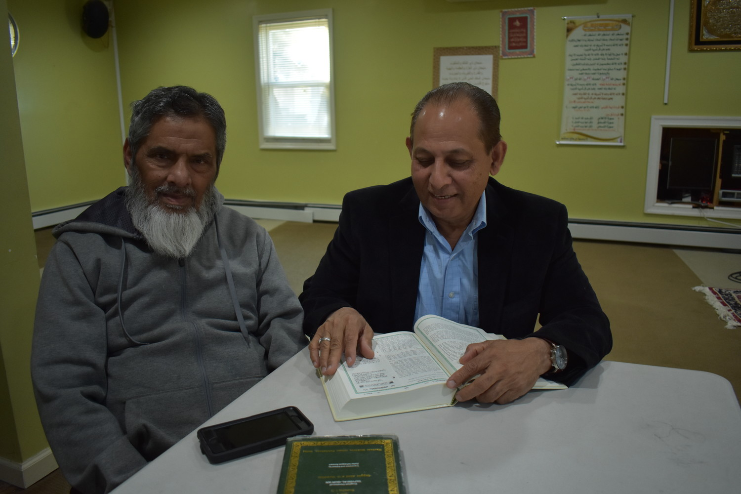Islamic Center president, Tanvir Ahmad, right, and member Syed Sajid Husain read the Quran, a daily part of observing Ramadan.