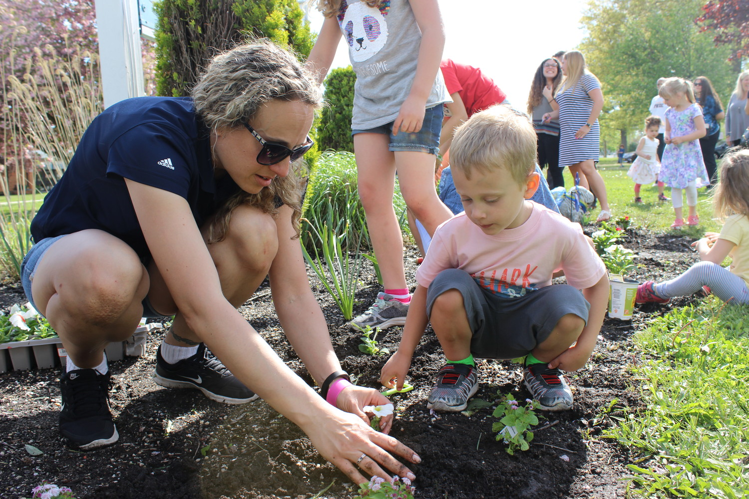 Marissa Gorlasky planted flowers with her son Alexander, a pre-kindergarten student at Bowling Green Elementary School.