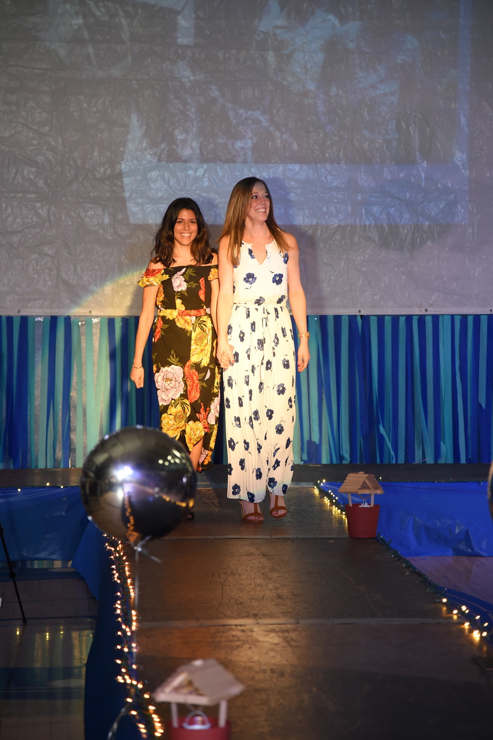 Teachers Ms. Clarke and Ms. Feldman walked the runway as well.