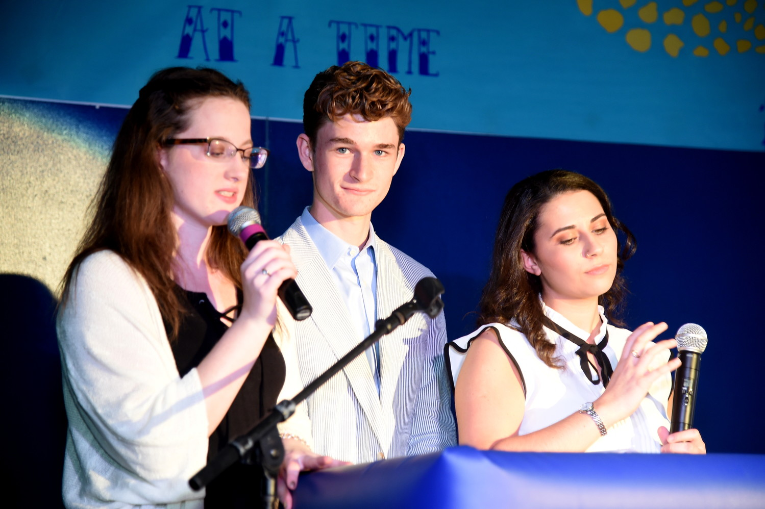 Alyssa Walsh, left, Jacob Goldberg and Sophia Mennito emceed a portion of the fashion show.