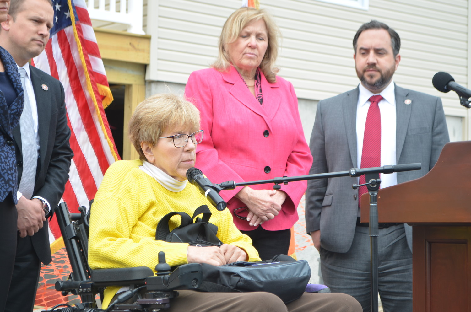 West End resident Liz Treston was joined on Monday by Nassau County officials outside her Hurricane Sandy-damaged home, where she urged victims of contractor fraud to file their cases with the county's Office of Consumer Affairs.