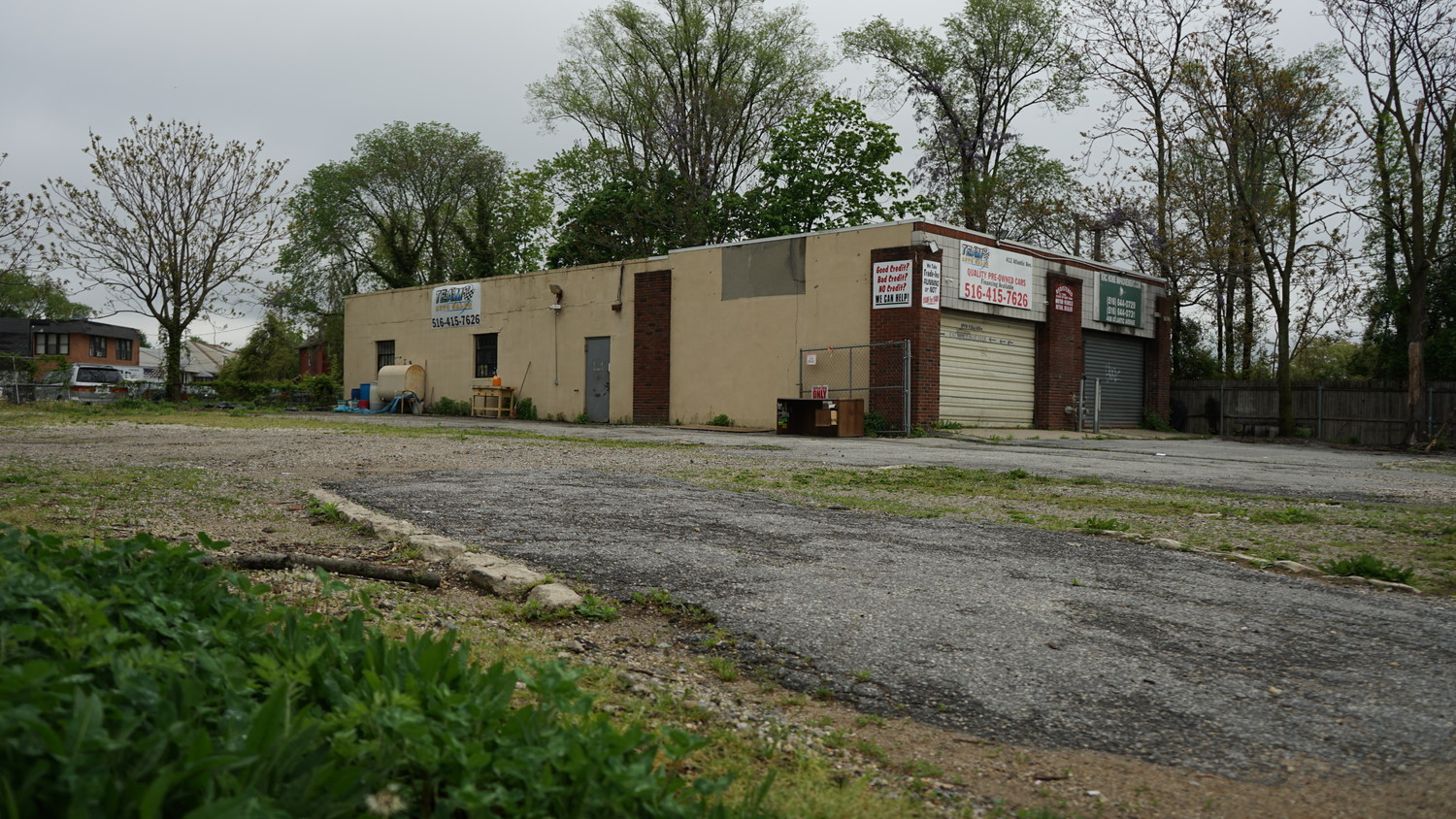 A local architect submitted a site assessment that revealed soil contamination on this Atlantic Avenue used car lot at a May 9 Board of Zoning Appeals hearing, as the owner sought to obtain town permission for his plan to improve the property.