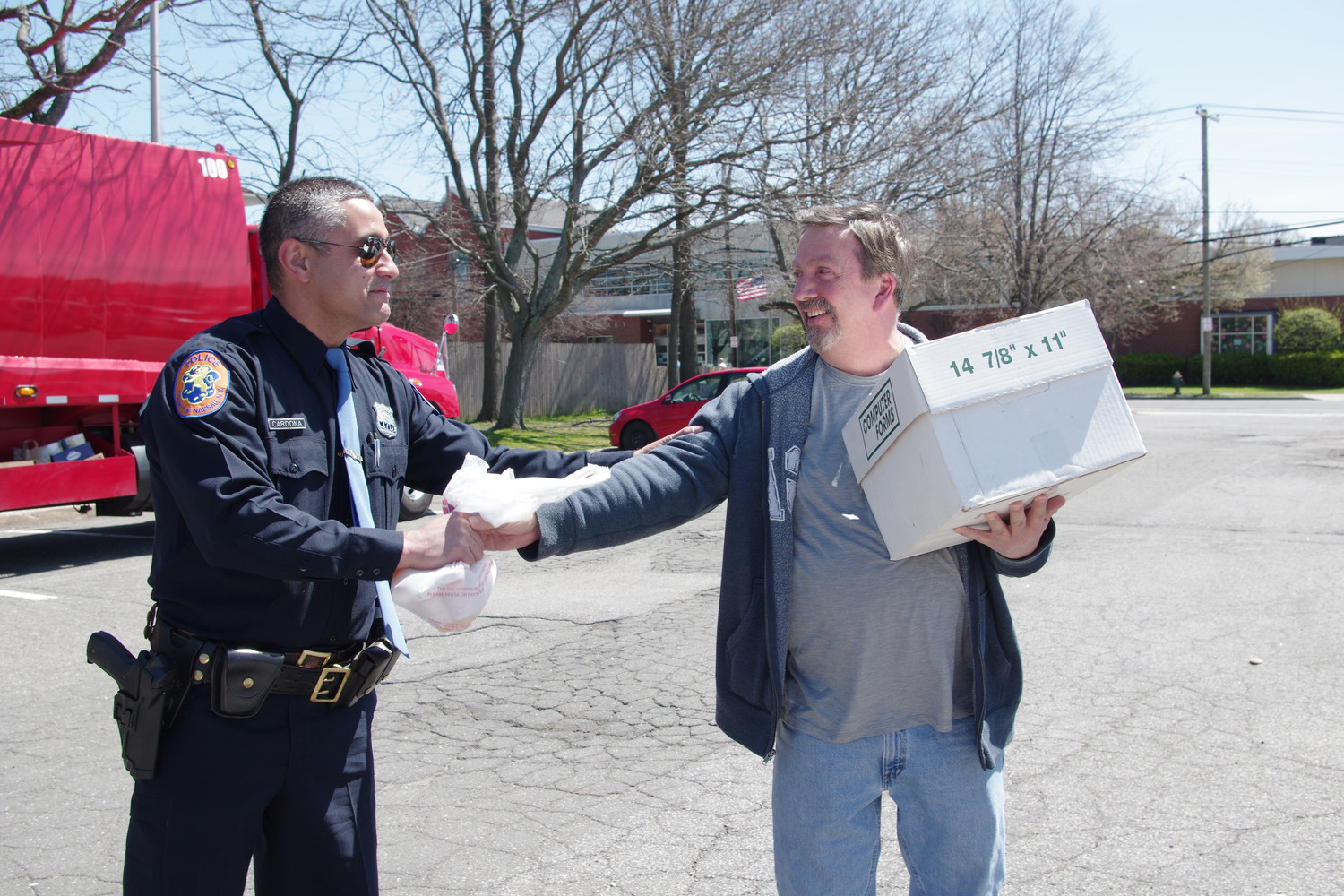 Nassau County police officer Jethrow cardona, left, collected medication waste from an Oceanside resident.