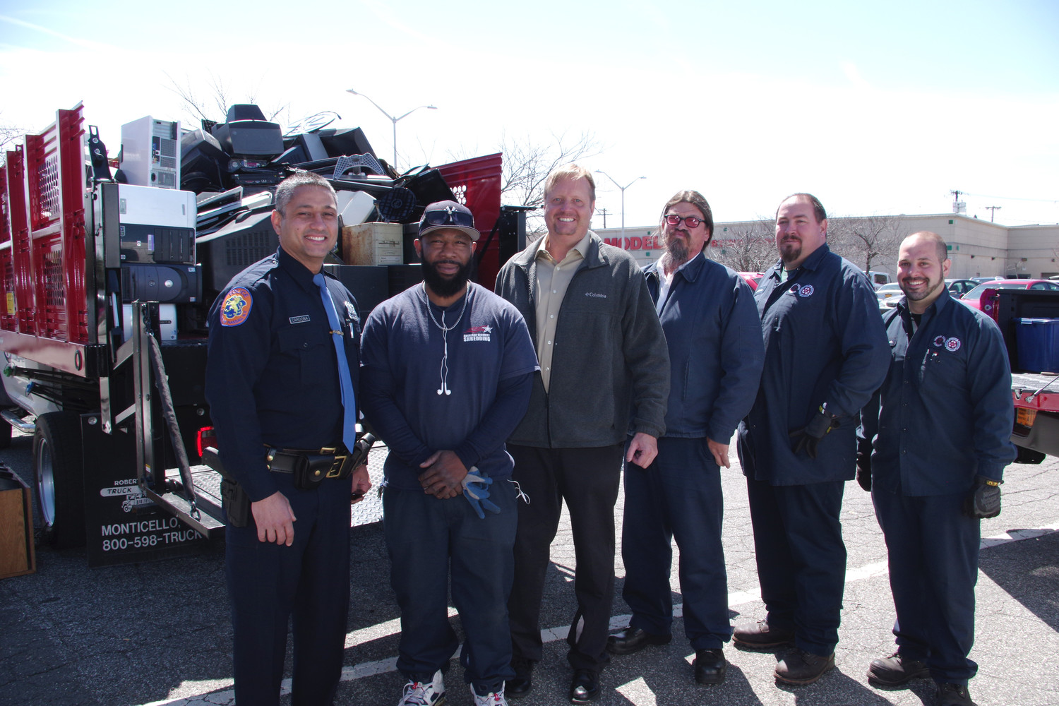 Officer Cardona, left, Tajahn Thomas, Sanitation Supervisor Dan Faust, Louis Catalanotto Jr., David Johnson and Matthew Amato.