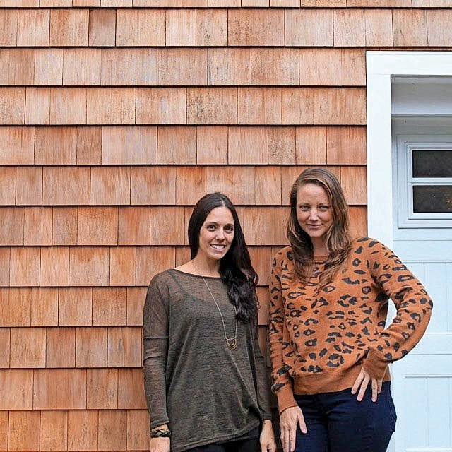 Wolf & Wing Interior Design's Kerri Venti, left, and Amanda Moore designed the eco-friendly home.