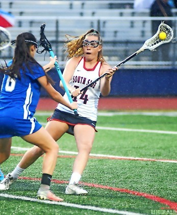 Senior Jolie Creo, right, contributed to South Side's 19-4 victory over Calhoun in a Class B quartrerfinal on May 16 with a goal and two assists.