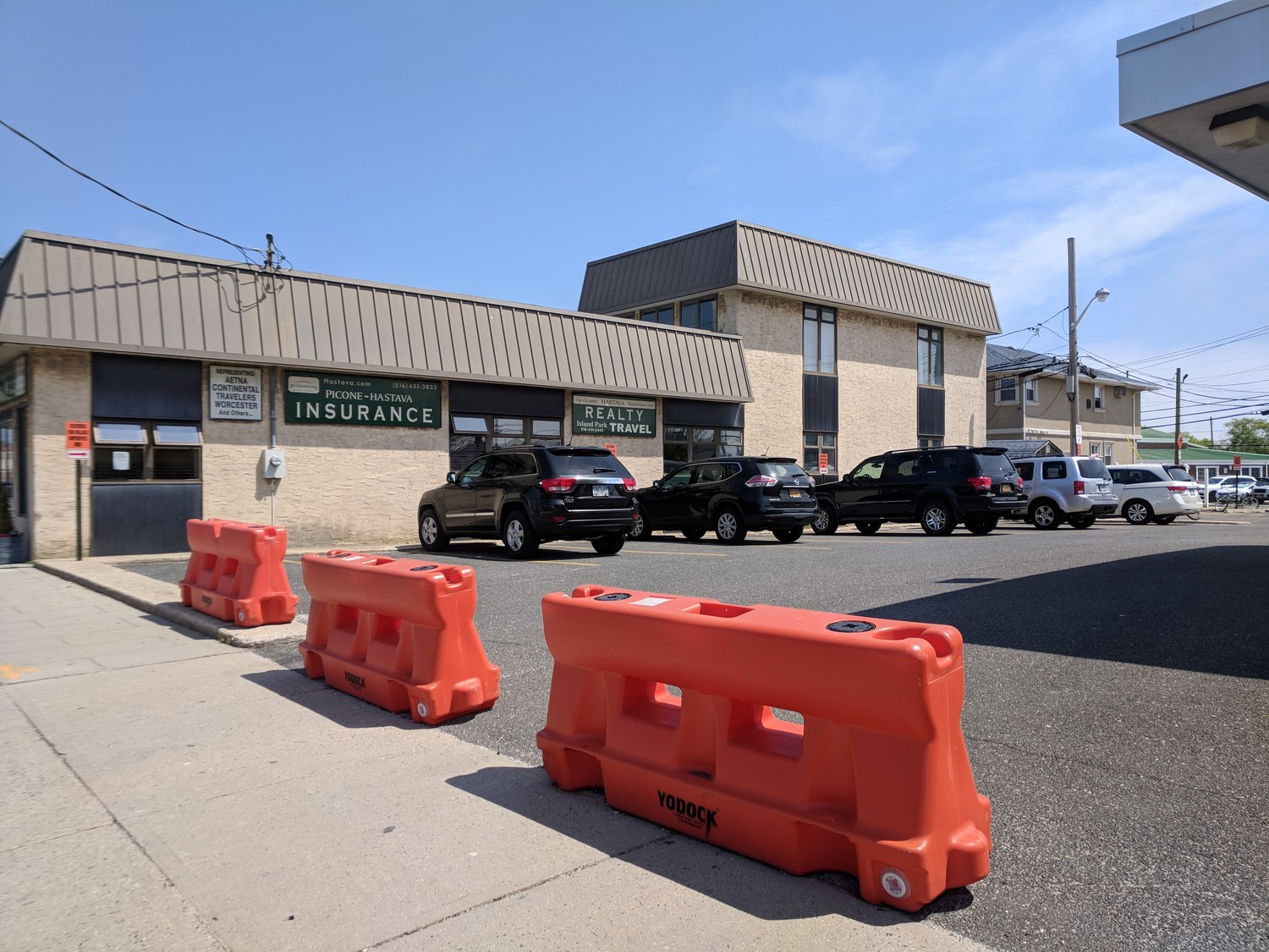 When Island Park's Village Hall relocated to the former Bank of America building on Long Beach Road last September, it took over roughly 20 parking spaces that had been available to shoppers.