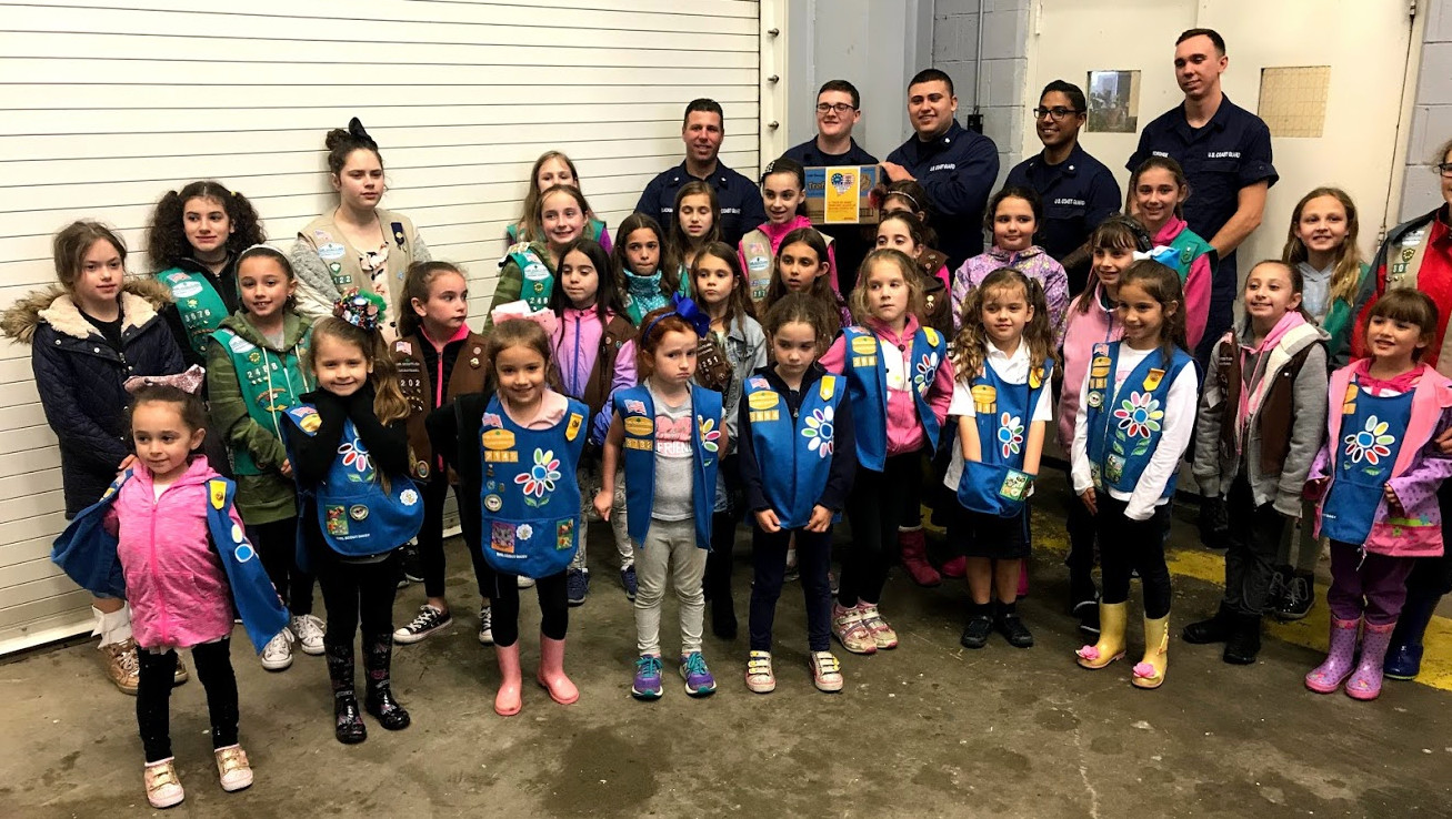 The Girl Scouts of Oceanside who sold 100 or more boxes of donated Girl Scout cookies through the Operation Cookie program were honored with the privilege of attending the Cookie Drop event at the United States Coast Guard station in Jones Beach.