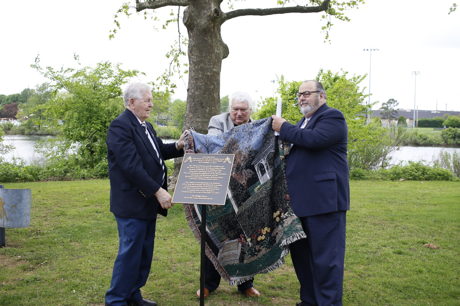 Frank Seipp, president of the Phillips House Museum, left, Dr. Michael Orzano, trustee for the Museum, and Mayor Francis X. Murray unveiled a plaque on May 20 that commemorates the founding of the Town of Hempstead.