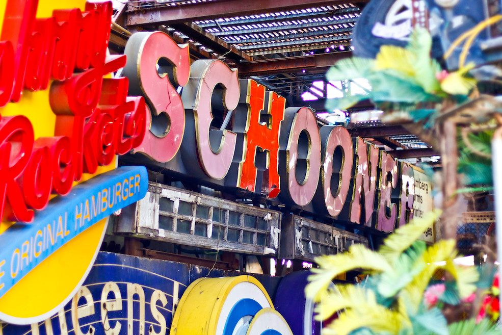 The old Schooner restaurant sign found a home among others at the yard.