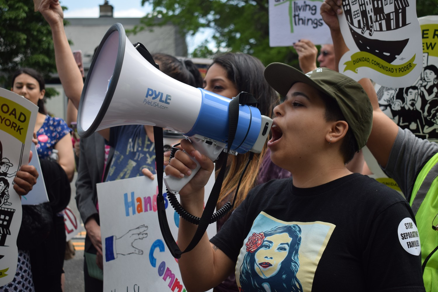 Newly naturalized American citizen Nicole Nuñez led the chanting among protesters on May 23.
