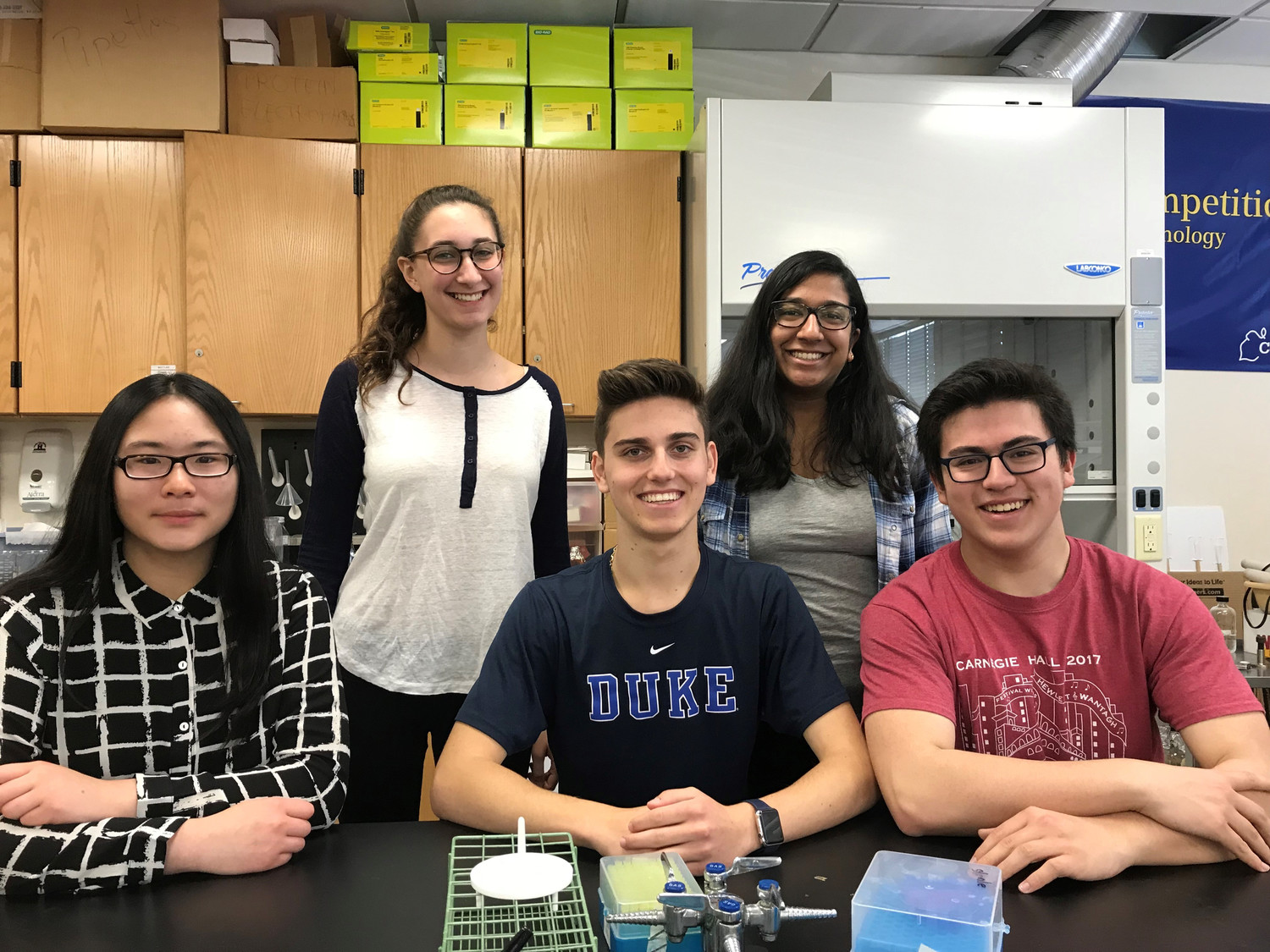 Chestine Tomas, far left, Samuel Bogdanov and Brandon Weiss, all Hewlett High juniors, are finalists in the Spellman High Voltage Electronics Clean Tech Competition. Julia Grossman, back left, and Bharvi Chavre were semifinalists in the science contest.