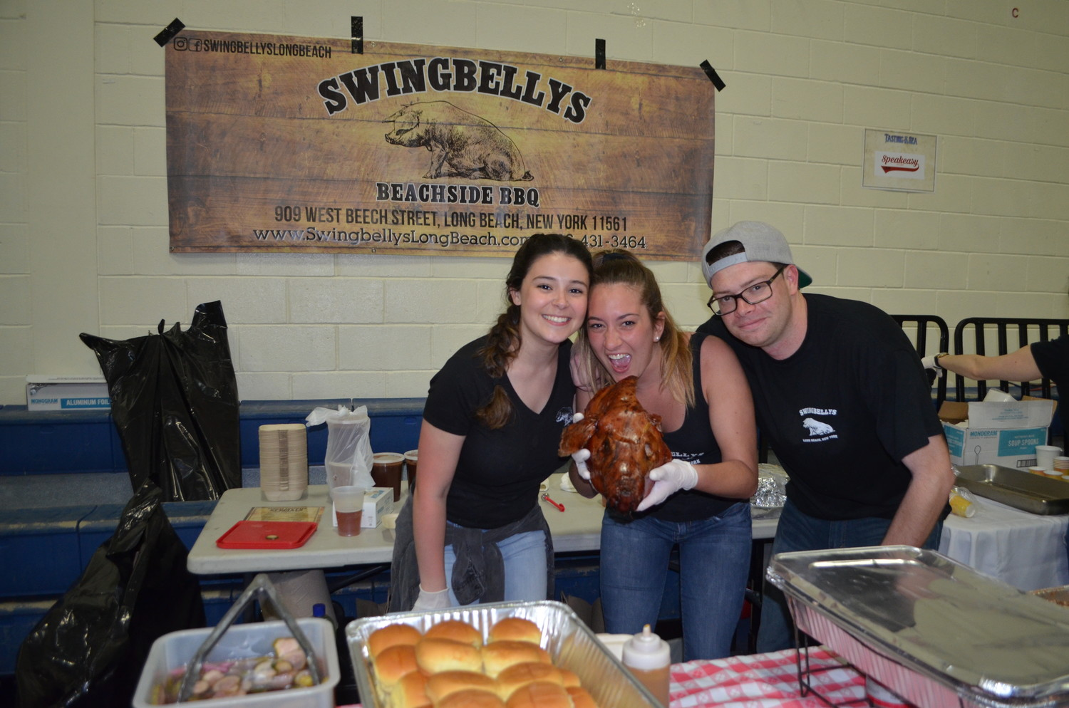 Gianna Yenna, left, Jessica King and Ryan Moroney of Swingbellys served pulled pork sliders.