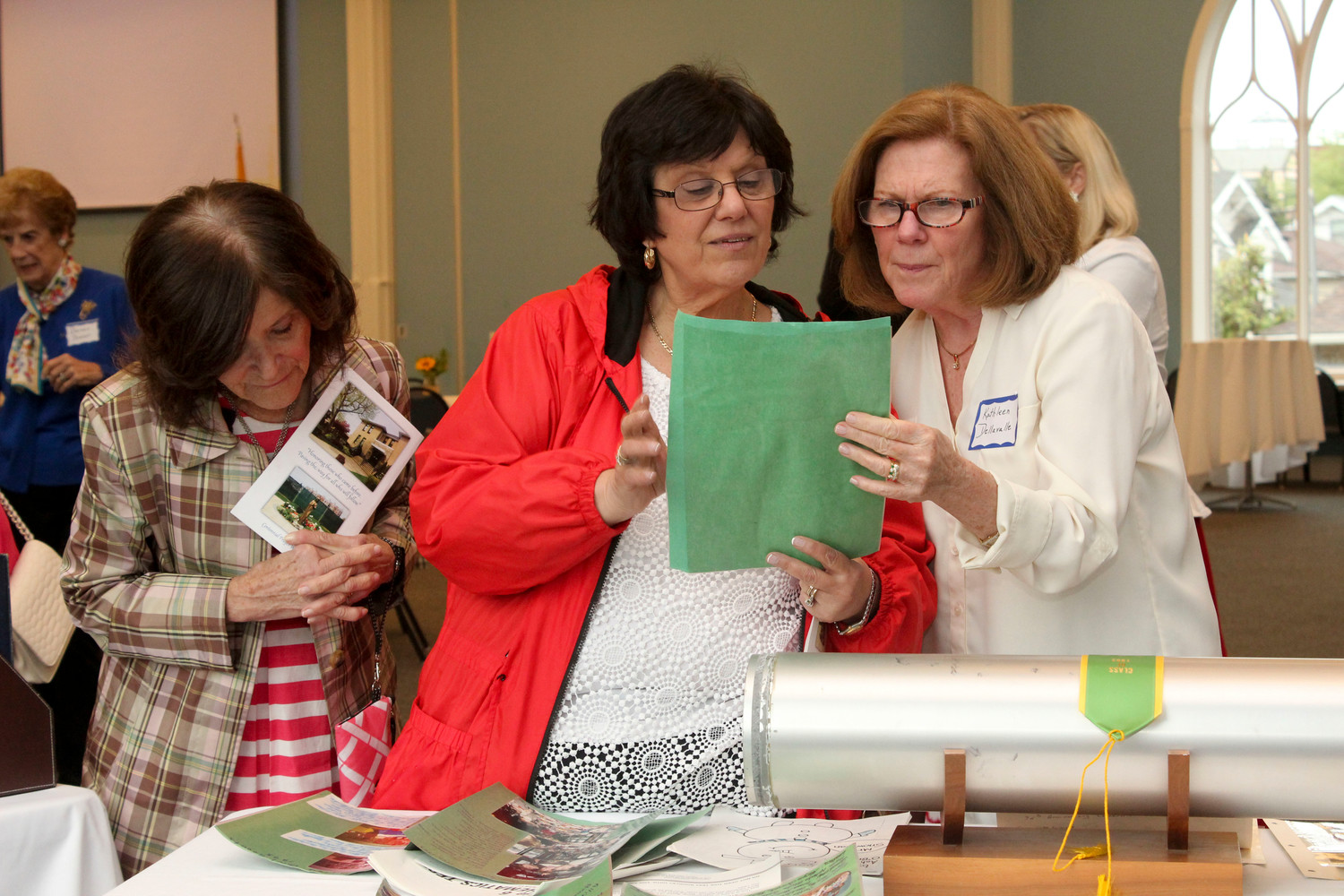 St. Agnes teachers Lorraine Mayo and Kathleen Dellavalle inspected the contents of a time capsule sealed 25 years ago.
