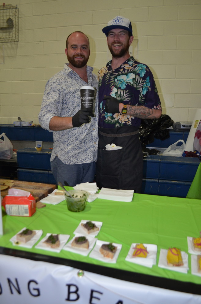Shane Herbert, left, and Michael Blackburn of Blacksmith's Breads served samples of their breads and spreads.