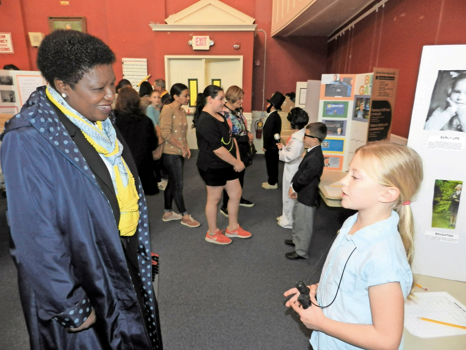 Assistant Superintendent Olivia Buatsi learned about the life of Jane Goddall from third grade student Madison Petersen.