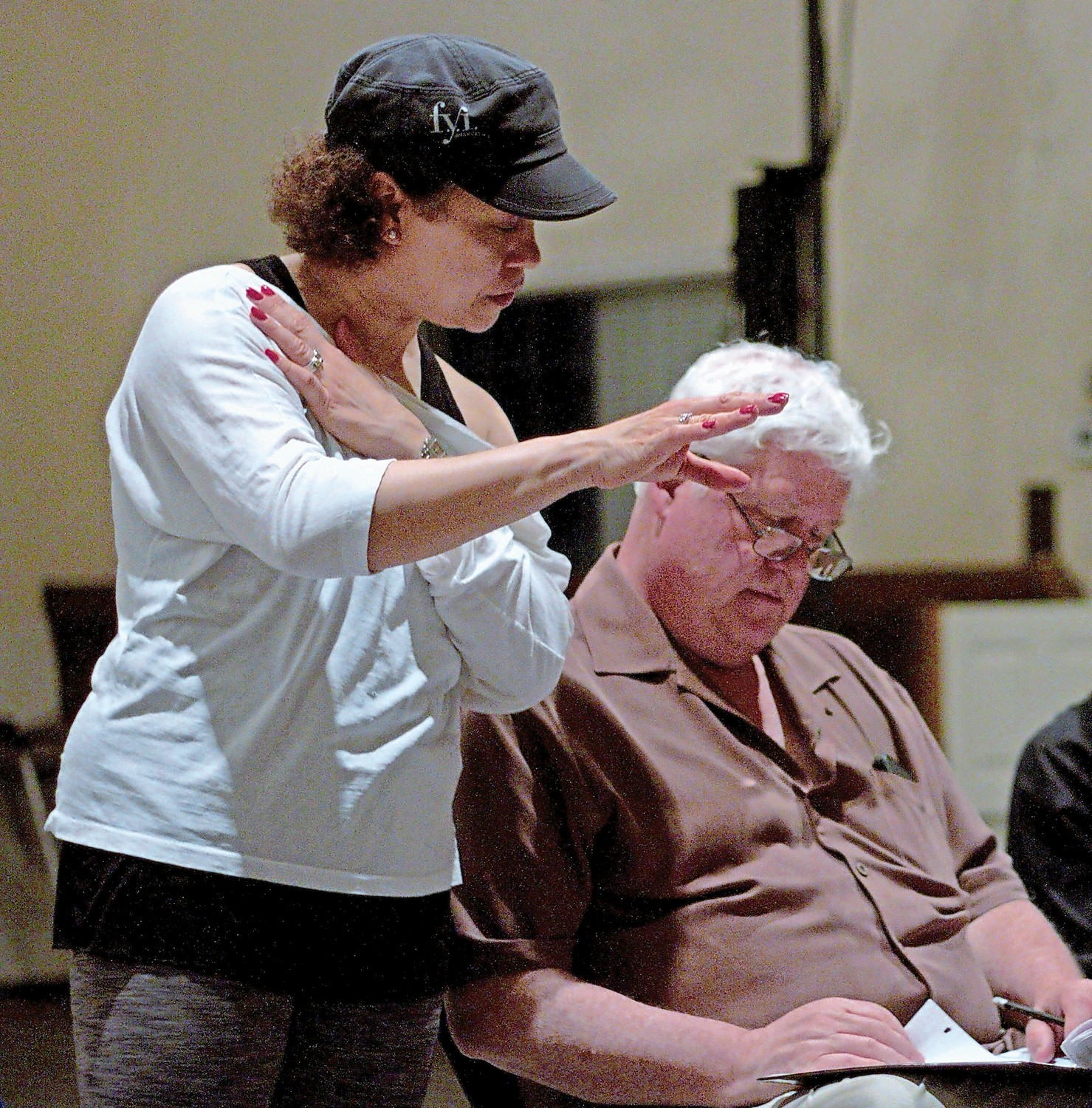 Assistant Director and Choreographer Judith Rivera, of Sea Cliff, and Patrick Reilly, the director, reviewed a few notes during rehearsal.